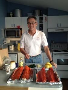 Peter Kearney preparing salmon for volunteers' dinner