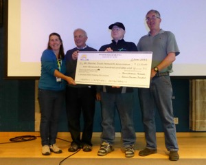 Mick Allen receiving the cheque for BCMTNA. Pictured: Roxanne Rousseau, Nick Heath, Mick Allen, Randy Chatterjee